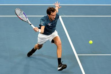 Daniil Medvedev of Russia hits a return in his men's singles match against Novak Djokovic of Serbia at the ATP Cup tennis tournament in Sydney on January 11, 2020.
