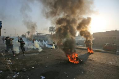 Anti-government protesters tried Monday to block central Baghdad streets with burning tyres