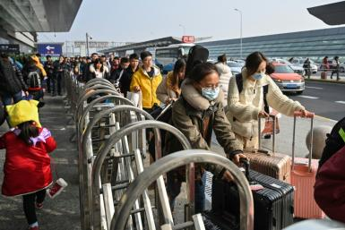Hundreds of millions of Chinese people head to their hometowns for Lunar New Year but many travellers seemed unfazed by the mystery virus