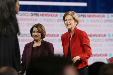 """The New York Times has endorsed Senator Elizabeth Warren (pictured December 2019) as its """"radical"""" pick for the Democratic presidential nominee and Senator Amy Klobuchar as its """"realist"""" one"""