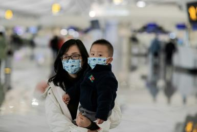 Airport health screenings have been stepped up across China and Asia, including at Beijing's Daxing airport, seen here -- in the US, five international airports will now check passengers arriving from the Chinese city of Wuhan