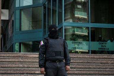 The tower where the offices of Venezuelan opposition leader Juan Guaido are located was surrounded by hooded and armed Sebin intelligence officers dressed in black