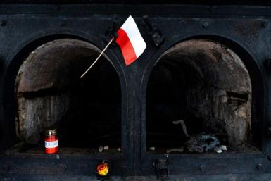 A Polish flag waves in front of a crematorium oven at the former site of the Gusen death camp in Austria, which Warsaw is pushing to be memorialised
