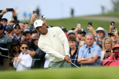 Tiger Woods fired a one-under par 71 in Friday's second round of the US PGA Farmers Insurance Open