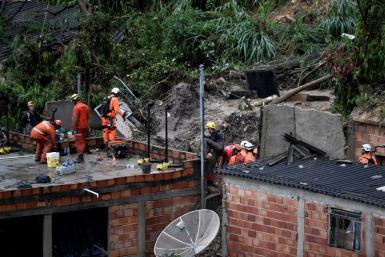 Rescue workers looked for victims after two houses collapsed during record rainfall in southeastern Brazil