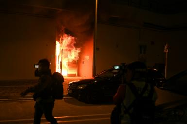 A fire raged at the entrance to one of the buildings earmarked as a virus quarantine centre