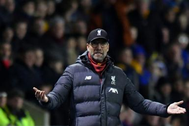 Jurgen Klopp's decision to make 11 changes to his Liverpool side backfired in a 2-2 draw at Shrewsbury