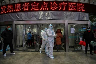 Medical staff outside the Wuhan Red Cross Hospital, where resources are stretched to the limit