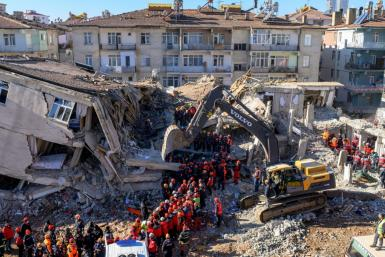 Nearly 4,000 rescue workers combed through debris in freezing temperatures, helped by mechanical diggers, in vain hopes of finding anyone alive