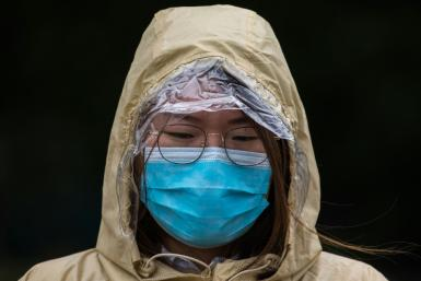 A woman wears a mask in Hong Kong as a preventative measure following a coronavirus outbreak which began in the Chinese city of Wuhan