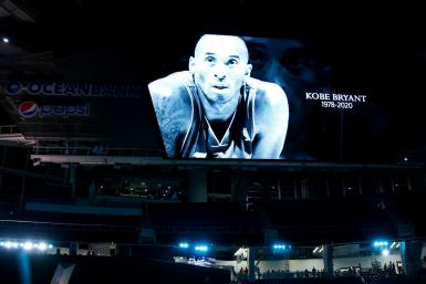 The death of NBA icon Kobe Bryant loomed over the build-up to the Super Bowl as the festivities began with a moment's silence observed as a giant screen displayed a photo of Bryant