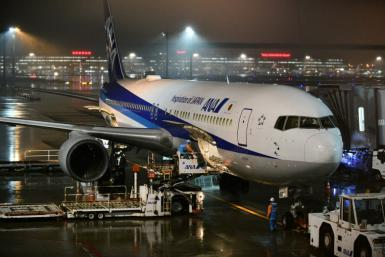 An ANA plane chartered by the Japanese government has gone to Wuhan to evacuate Japanese nationals from the epicentre of the China coronavirus outbreak -- here, the plane is seen before leaving Tokyo