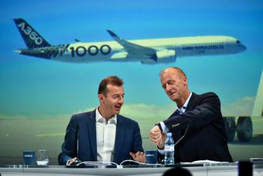 An internal Airbus probe was a factor in the departure of executive chairman Tom Enders (R), who was replaced as chief executive by Guillaume Faury (L)
