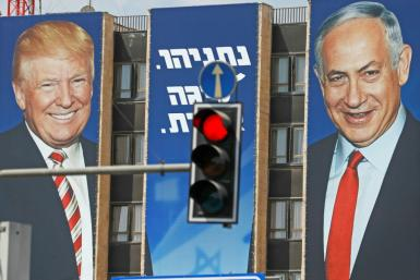 An Israeli election banner pictured in September 2019 bears the portraits of US President Donald Trump (L) and Prime Minister Benjamin Netanyahu hanging on a building facade in Jerusalem