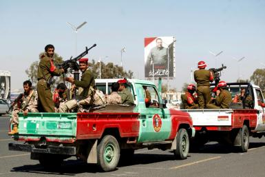 Members of the Yemeni Iran-backed Huthi rebels military police parade in the streets of the capital Sanaa on January 8, 2020