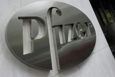 Pfizer reported a fourth-quarter loss on lower sales but said the company was on track to reengineer itself to focus on new game-changing pharmaceuticals