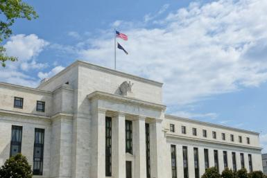 The US Federal Reserve has signaled it will only shift interest rates if there is a 'material' change to the economic outlook