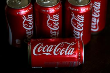 Shares of Coca-Cola rose as it reported higher sales, with especially good growth in Asia and Latin America