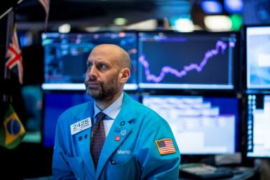 Traders at the New York Stock Exchange (NYSE) on January 29, 2020; Government data show slowing economic growth in the US