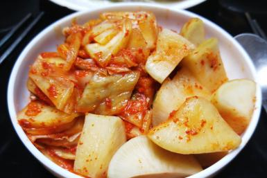 Adverse weather limted the cabbage crop, squeezing the market for South Korean-staple kimchi.