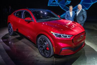 Ford CEO James Hackett (R), shown here at the November 2019 unveiling of the Mustang Mach-E, vowed that the all-electric vehicle will help turn around Ford's fortunes