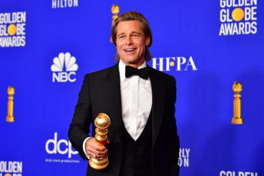 "The acting categories appear to be a lock for the Oscars, with Brad Pitt -- seen here with his Golden Globe -- expected to win for best supporting actor for ""Once Upon a Time... in Hollywood"""