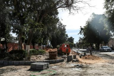 Construction crews are building new highways through Heliopolis and uprooting its century-old trees