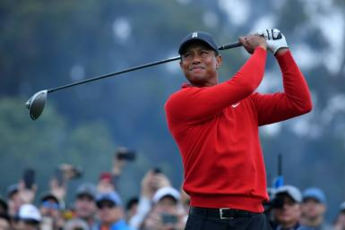"""Tiger Woods, seen here teeing off on the 18th hole at Torrey Pines, says finding a solution to golf's ever-increasing hitting distance is """"a delicate balancing act"""""""