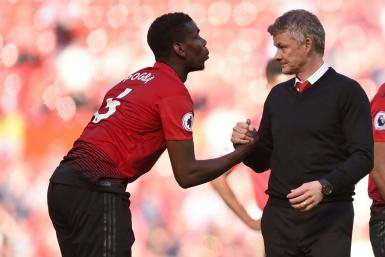 He's ours: Manchester United manager Ole Gunnar Solskjaer (right) does not want Paul Pogba (left) to leave the club