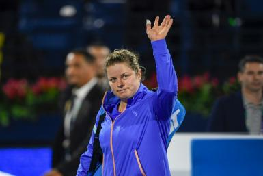 Kim Clijsters waved goodbye to the WTA event in Dubai following first round defeat to Garbine Muguruza