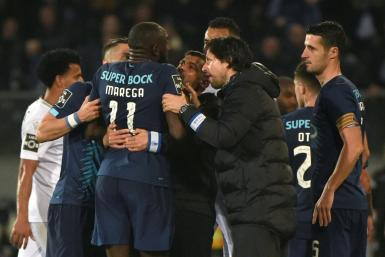 Players from both sides as well as Porto coach Sergio Conceicao attempted to stop Moussa Marega from leaving the pitch