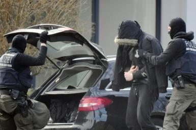 Prosecutors said Friday they had launched early morning raids to determine whether the suspects already had weapons or other supplies that could be used in an attack