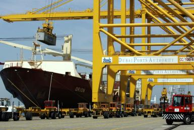 State-owned parent company Port and Free Zone World has offered to acquire the 19.55 percent of DP World's shares traded on the Nasdaq Dubai; A file picture from March 14, 2006 shows a cargo ship docked at Dubai's Jebel Ali port