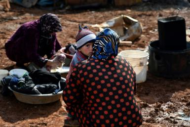 Syrian internally displaced persons (IDPs) are pictured in a camp in Sarmada in the north of Syria's northwestern Idlib province on February 17, 2020.