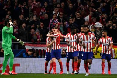 Atletico Madrid's Saul Niguez (C) celebrates scoring an early goal against Liverpool at the Wanda Metropolitano on Tuesday.