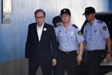 Former South Korean president Lee Myung-bak arriving at court to attend his original trial in 2018