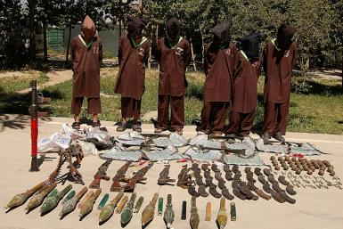 Haqqani network militants paraded with captured weapons in Kabul. The head of the network, who is also the deputy leader of the Taliban, said the group was fully committed to a peace deal with the United States