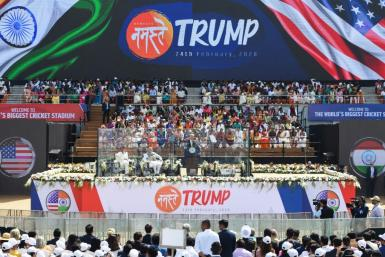 Trump and Modi speak from behind bullet-proof screens during a rally at Sardar Patel Stadium in Ahmedabad