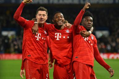 (From left) Robert Lewandowski, David Alaba and Alphonso Davies celebrate Bayern's third goal at Chelsea