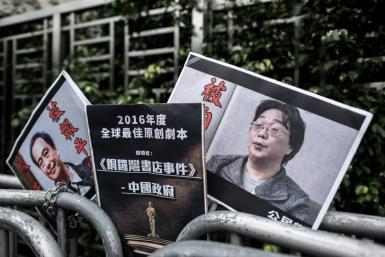 Gui Minhai (R), one of five Hong Kong-based booksellers known for publishing salacious titles about Chinese political leaders was snatched by Chinese authorities while on a train to Beijing in February 2018