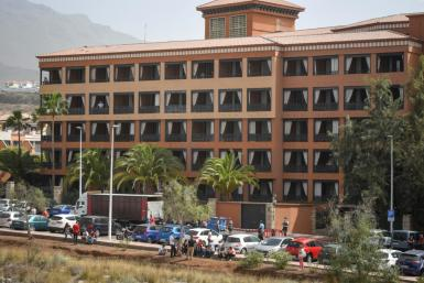 Police wearing masks and gloves could be seen surrounding the hotel in Costa Adeje on the southwestern shore of Tenerife