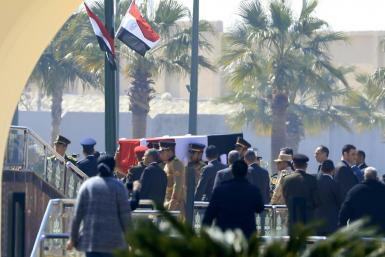 Egyptian honour guards carry the coffin of former president Hosni Mubarak before his funeral ceremony at Cairo's Mosheer Tantawy mosque in Cairo