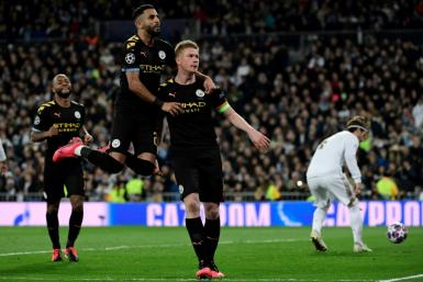 Kevin de Bruyne (right) celebrates scoring a winning penalty as Manchester City beat Real Madrid 2-1 on Wednesday at the Santiago Bernabeu.