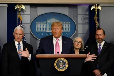 US President Donald Trump, flanked by Health and Human Services Secretary Alex Azar (R), US Vice President Mike Pence (L) and CDC Principal Deputy Director Anne Schuchat, holds a news conference on the COVID-19 outbreak