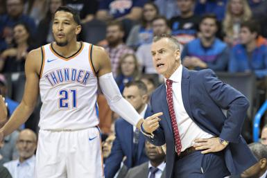 Head Coach Billy Donovan and Andre Roberson #21 of the Oklahoma City Thunder