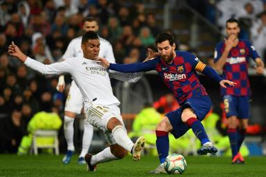 Real Madrid midfielder Casemiro challenges Barcelona's Lionel Messi