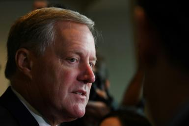 Although incoming US chief of staff Mark Meadows (pictured November 2019) is not exhibiting symptoms, and a precautionary test came back negative, he is going into self-quarantine after being exposed to the coronavirus