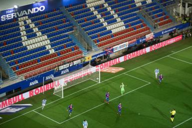 The match between Eibar and Real Sociedad, cancelled in February following a landslide into a nearby rubbish dump, on Tuesday became the first Liga game played behind closed doors because of coronavirus