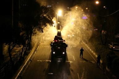 Iranian firefighters disinfect streets in Tehran to tackle the spread of coronavirus