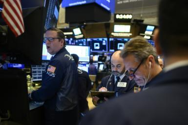 "Wall Street plunged in futures trading, with the Dow Jones Industrial Average ""mini"" index losing more than 1,000 points or 4.5 percent, and the S&P 500 and Nasdaq posting similar declines"